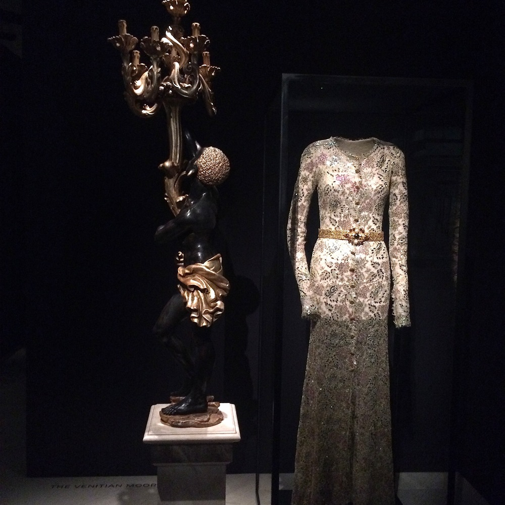 One of totems is simply a Coco Chanel's creation and her inspiration: A baroque statue from her apartment and fully embroidered haute-couture dress.