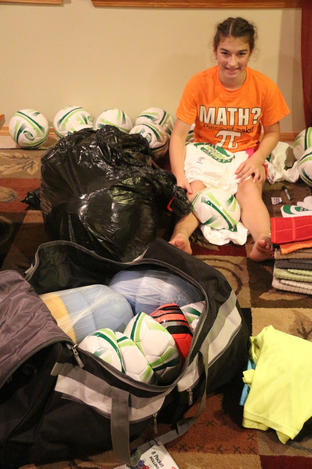 Hanna Michaelis helps pack the soccer gear
