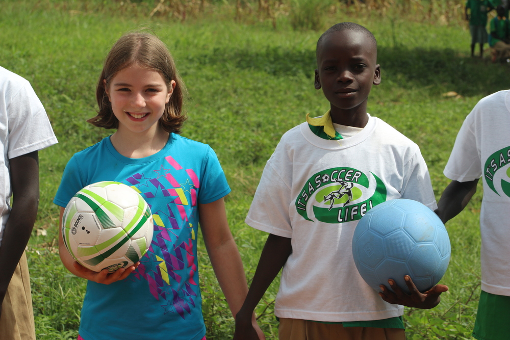 Abigail Michaelis shares the t-shirts and soccer balls with the school in Pajok, South Sudan