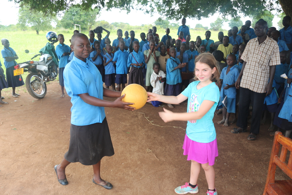 Donating a ball to Petya school in Kitgum, Uganda