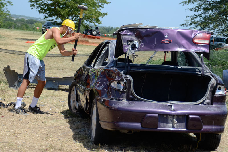 Man smashing purple car