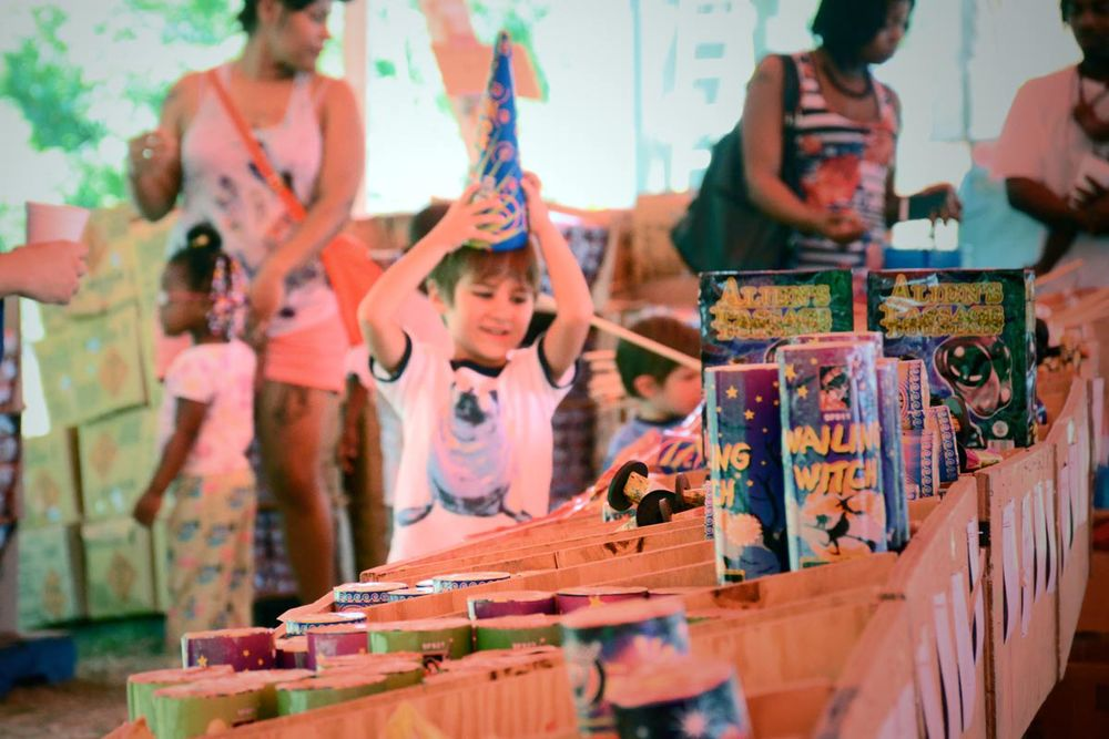 Little boy shopping with family for fireworks