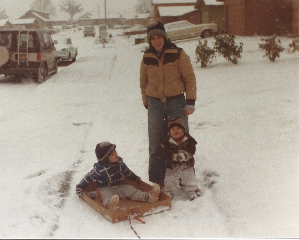 Candi loved watching me pull the kids in a homemade sled.