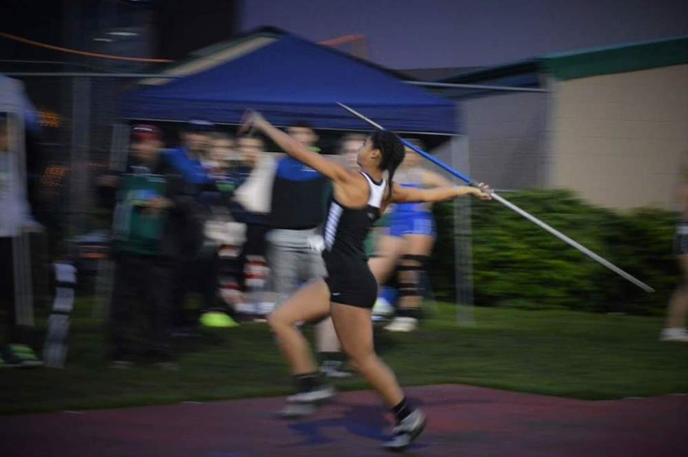 Keira throwing the Javelin in a big meet.