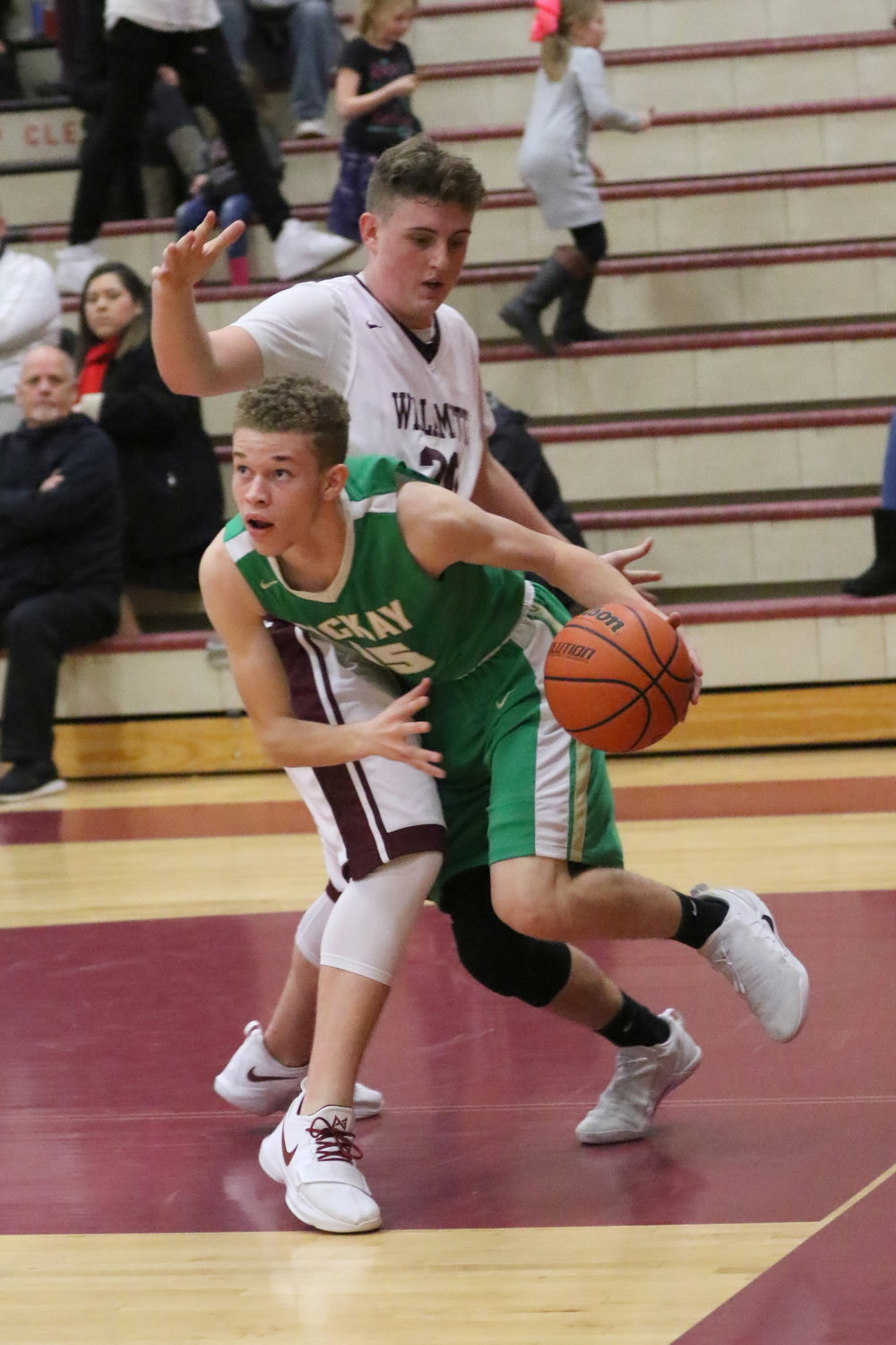 Khyler flashes by a Willamette defender. Photo by Kent Brewer.