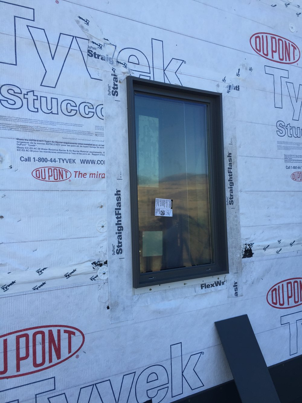 Triple-pane window flashed with Tyvek FlexWrap and StraightFlash.