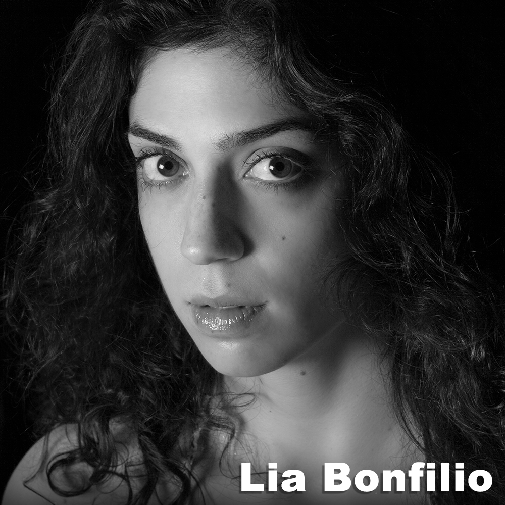 Lia Bonfilio  (Performer) is a performing artist and licensed massage therapist. She has been a Third Rail Projects company member since 2013 when she joined the cast of  Then She Fell.  Since then she has collaborated on several projects with TRP, including  Sweet & Lucky , for which she developed an original role and acted as rehearsal director. Since receiving a BA in dance from Columbia College Chicago in 2006, Lia has performed for Lucky Plush Productions, Mordine and Company Dance Theater, Joe Goode Performance Group, Peter Carpenter, Philippa Kaye, Levi Gonzalez, and Susan Rethorst. In 2012 Austrian director, Sina Heiss, created an evening-length one woman dance theater show for Lia, which she toured in Europe. Lia comes from Minnesota and lives in Manhattan.