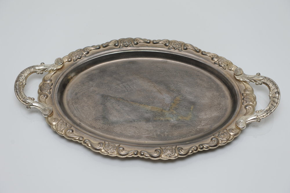 Round silver tray. $10