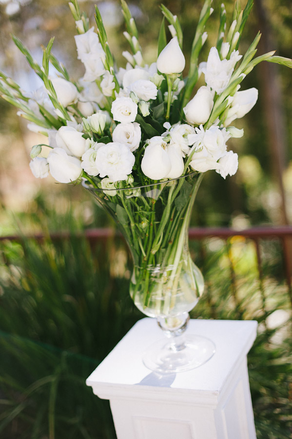 Vase of flowers on plinth