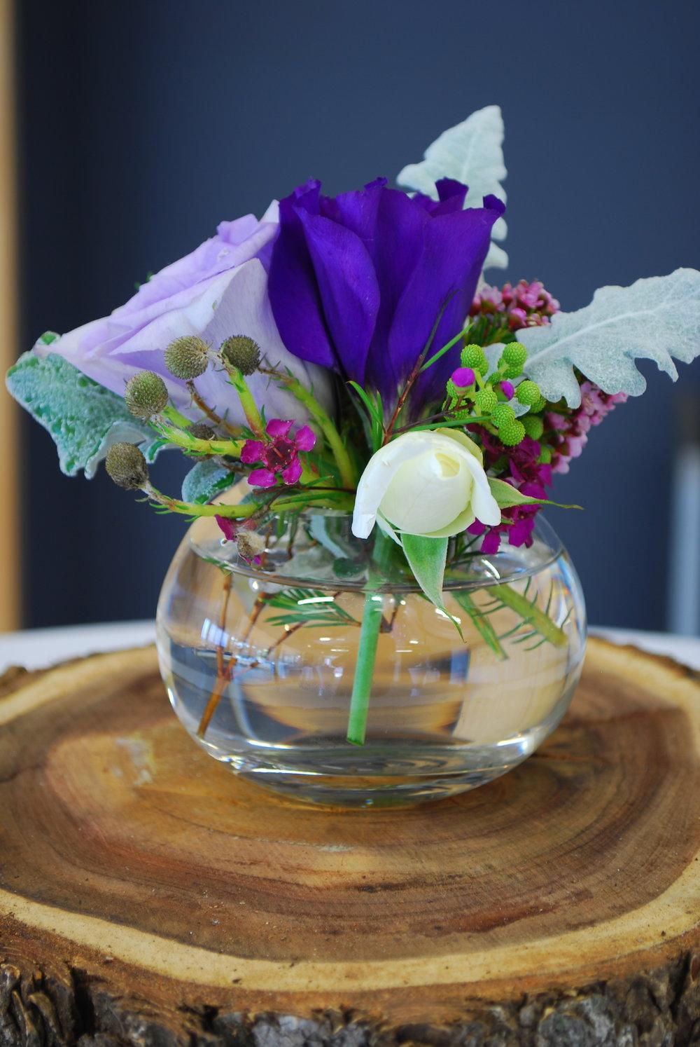 Wood base and vase of flowers