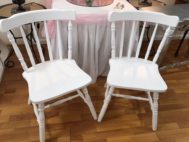 Matching white wooden chairs