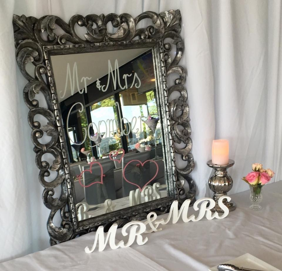 Silver framed mirror to write message on