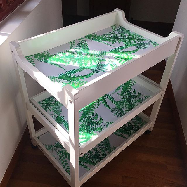 "Cha cha changes. Upcycled baby changing table with custom laminated cotton ""Crata Fern Leaves"" design from @crata.home . I was looking for an alternative to oil cloth (which is highly toxic) for this project and settled on this laminated cotton because it's a UE food grade approved packaging material that is free of PVC, lead and phthalates. This laminated cotton is finished with a polyethylene coating (full disclosure, a plastic resin), which makes it easy to clean, far less toxic and a bit of green fun for a nursery. Just add live plants 🌱 and baby 💚 🌿 🌿 🌿  #ferns #sustainableliving #sustainabledesign #interiordesign #interiordesignsg #ecofriendly #singaporenursery #singapore #singaporedesigner #babies #nurserydecor #changingtable #expatliving #sgbabies #upcycledfurniture #oilclothalternative #lowtoxicliving"