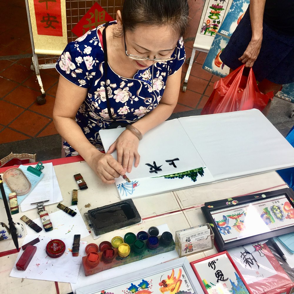 Chinatown calligraphy artist, Jessie Ren. She wasn't pleased about the fabric bleeding the ink but I didn't mind and we rolled with it.