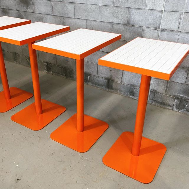 Tile top pedestal tables getting ready to head to Cairns. #restaurant #interiordesign #architecture #furnituredesign #tile #orange #table #restaurantdesign