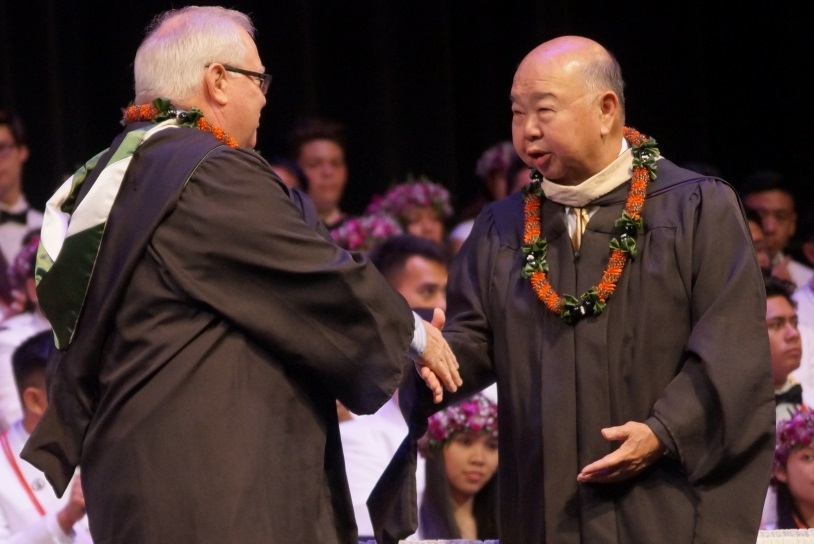Mr. Ho is congratulated by current Damien Chairman, Board of Directors, Gregory Sitar '78