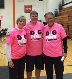 Dr. Adam Paikai at the  Volley 4 the Cure Fundraiser  at Wheaton-Warrenville South High School in Illinois, pictured with the school's volleyball coach and another cancer survivor