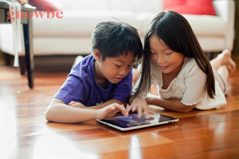 depositphotos_70902719-stock-video-asian-child-playing-smart-phone.png