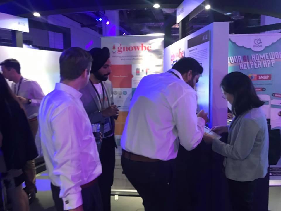 Gnowbe team showcasing the mobile platform.