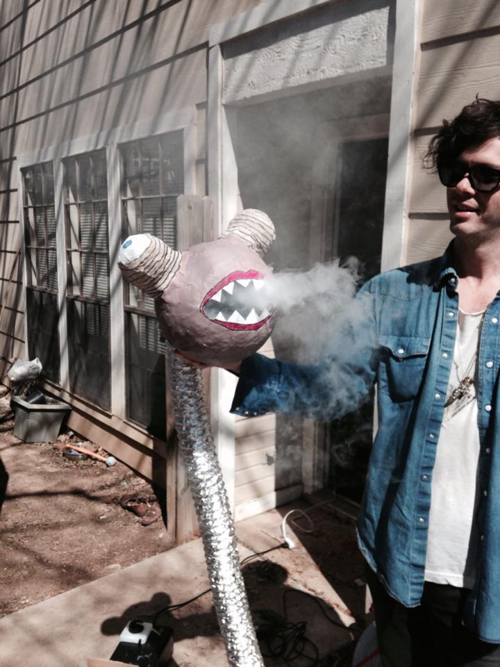 Drummer Zac Cowell holds the infamous snake monster.