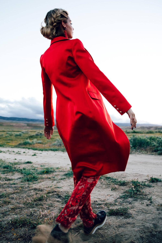 Jacket: Lotuz / Jumpsuit: Joey Galon Choker: Liv Bambina / Earrings: NMD / Rings: Gold Philosophy / Shoes: Stella McCartney