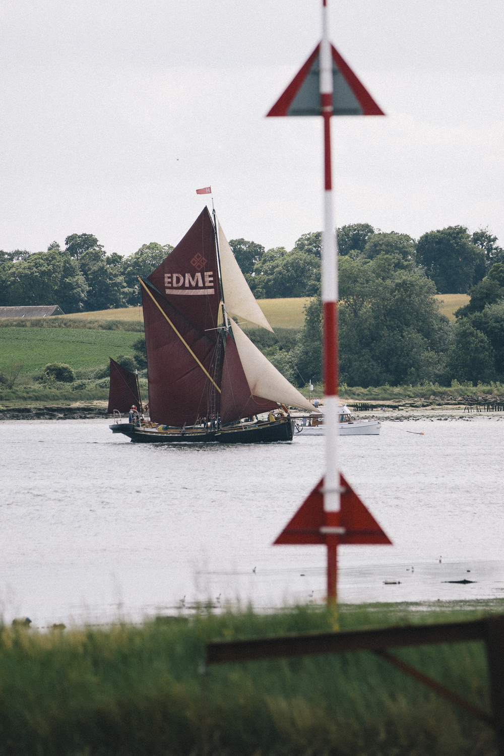 Edme, short tacking up the river Orwell towards the finish line at Pin Mill.  Pin Mill Thames Sailing Barge Match 2015, Photo by Emily Harris