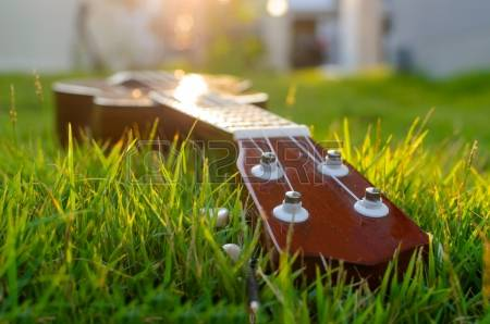 19255232-ukulele-put-on-the-grass-with-the-sunset-behind.jpg