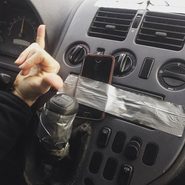 No radio? No problem!!! Nothing some tape and an iPhone playlist can't fix! The beauty of cheap rentals. About to arrive at the Wohngemeinschaft in Köln for our concert tonight. Come join us! #diyradio #ducktape #slightservicerustgoodrunner