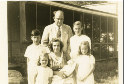 John Edward Blanchard, his wife Rosalie, with children John, Mary, Sophie, Agnes and baby Gene, in front the family home on Central Avenue, circa 1945.