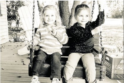 Adelyn Blanchard and Haley Marie Jeffreys, the eighth generation of Sullivan's Island Blanchards, sit in a swing made by their great-great grandfather. Circa 2015.