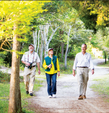 Nathan Dias, Julia Khoury and Pat O'Neil, Mayor of Sullivan's Island, take a stroll through the maritime forest.