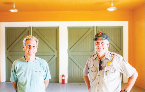 Hal Coste and Timothy Stone stand in the recently renovated Historic Coast Guard District Boathouse.