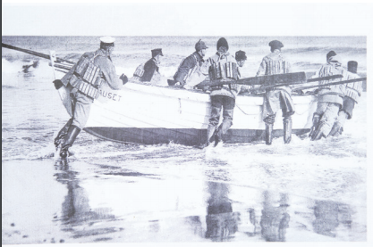 This image from Hal Coste's family archive shows surfmen launching their life boat.