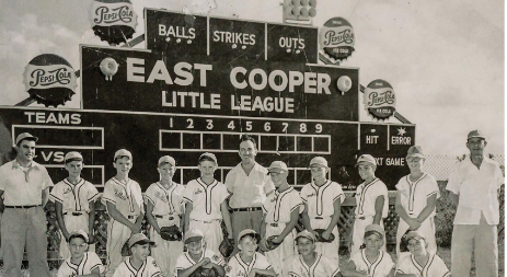 The East Cooper Little League All Star Team 1954/55 with representatives from the Cubs, Yankees, Phillies and Giants. The league played on a baseball field built on the old Fort parade ground. Back row: Mr. Johnny Moore, Mike Williams, Duncan Padgett, Carl Weeks, Roy Kimbrell, Mr. Johnnie Dodd, Haywood Davis, Don Easterlin, Ronnie Nettles, Tommy Price, Mr. Muller. Front row: George Jackson, LeGrand Norell, Archie Morris, Len Williams, Jackie Wear, Jimmy Cleary, Donny Snowden. (Photo from private collection of Jackie Wear).