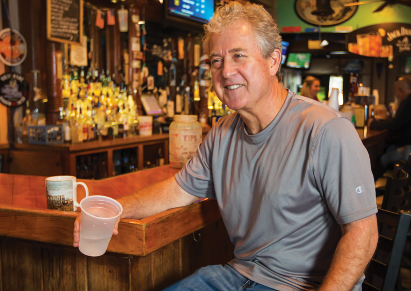 Bobby Ross enjoys a rare moment of quiet at The Windjammer's bar