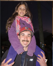 David Brahen helps his daughter Haley get a better view at the SI Christmas Tree Lighting