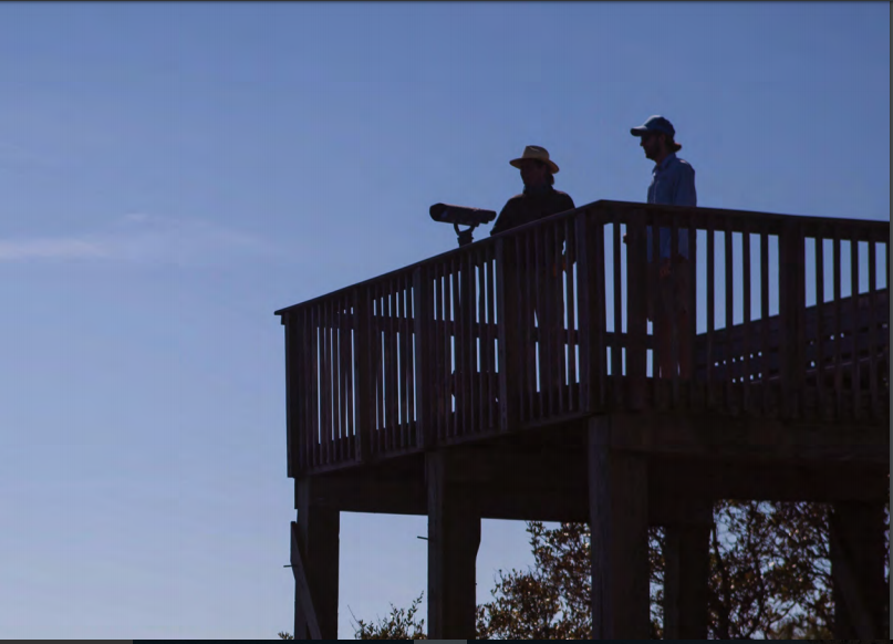 Captain Chris Crolley and author Stratton Lawrence look out from the observation deck toward the ocean, over Jack's Creek pond.