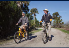 Stratton Lawrence and Chris Crolley biking along the Beach Road.