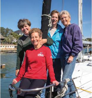 "Retired Navy nurses, Arlene Southerland, Alice Bova, Linda Daehn and Sue Widhalm still enjoy a sailor's life on Southerland's sailboat ""Serenity.""  (Photo by Steve Rosamilia)."