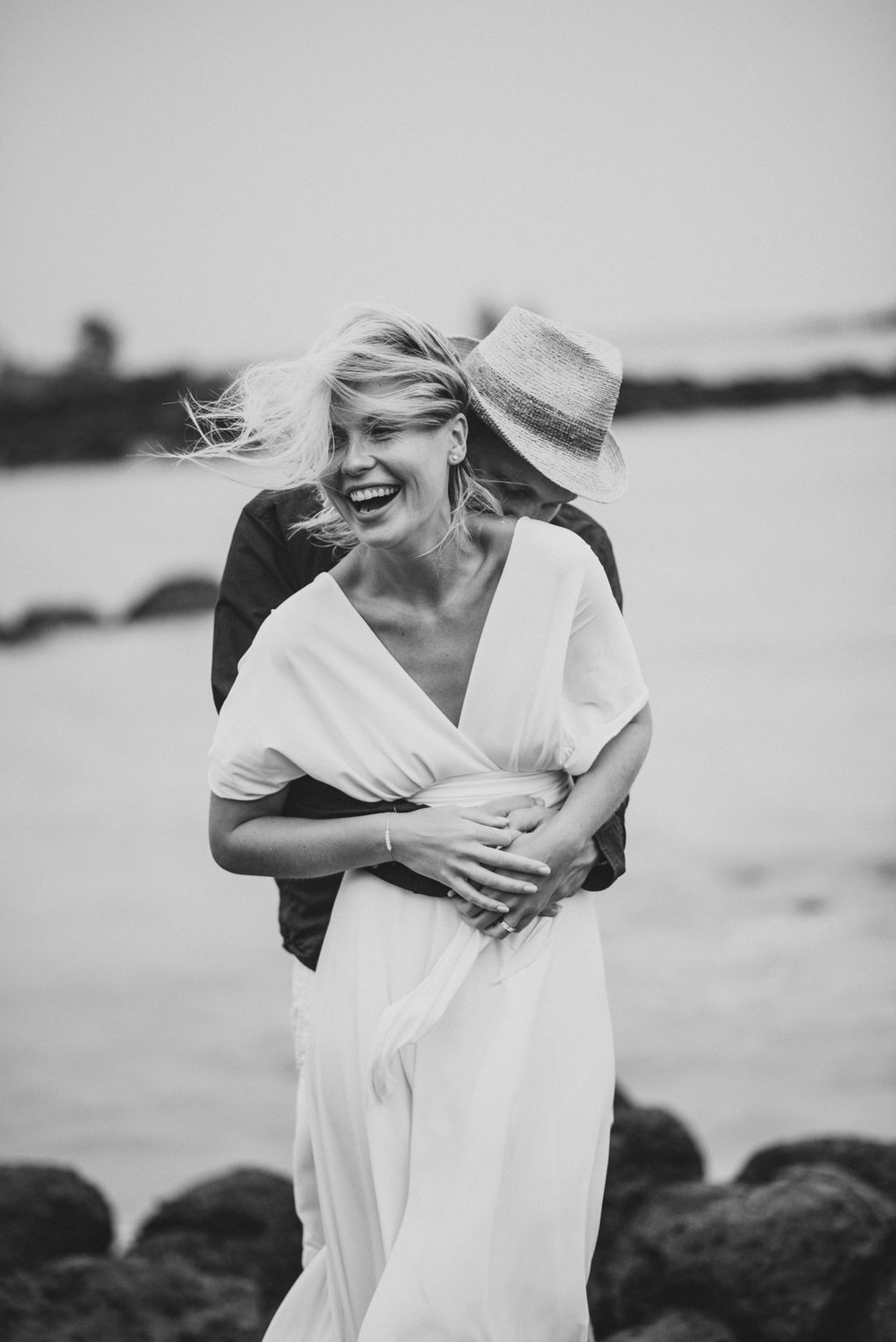 Copy of Sita Kelly | Mauritius Honeymoon Photographer | man kissing woman's neck, woman laughing