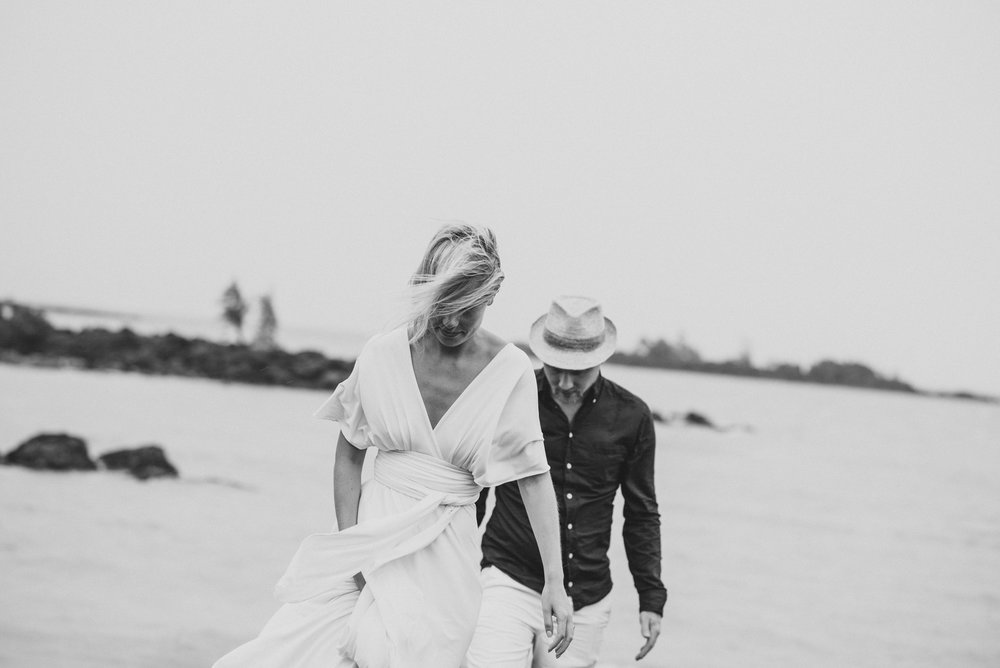 Copy of Sita Kelly | Mauritius Honeymoon Photographer | Couple walking on rocks