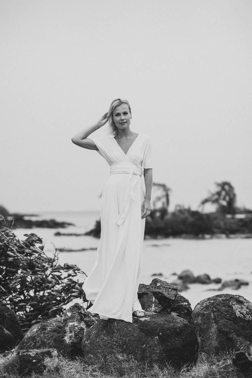 Copy of Sita Kelly | Mauritius Honeymoon Photographer | woman in a white dress standing on rocks and touching her hair