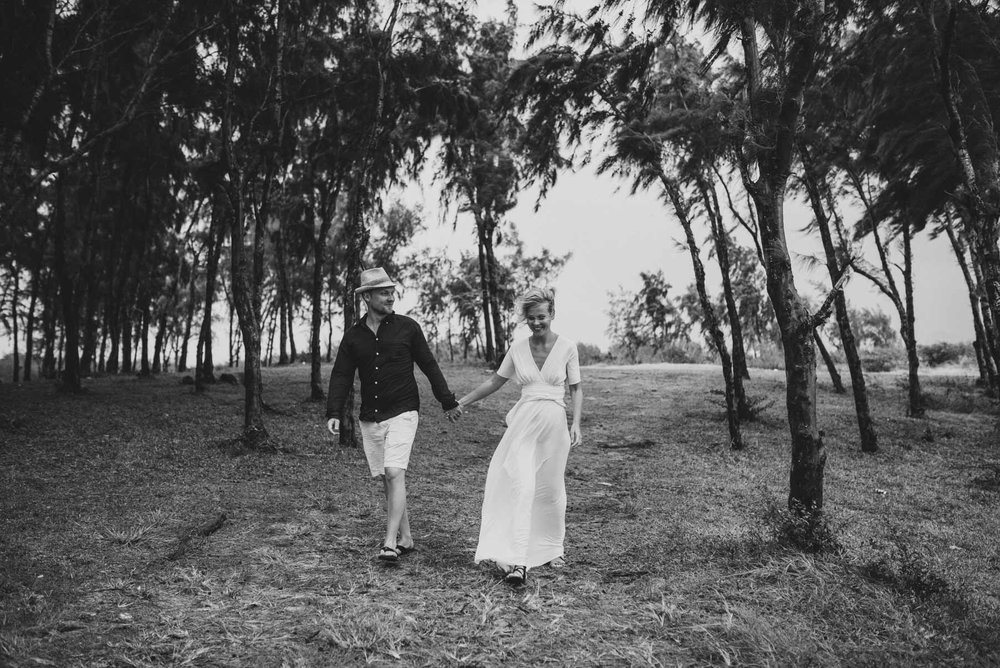 Copy of Sita Kelly | Mauritius Honeymoon Photographer | Couple walking through trees