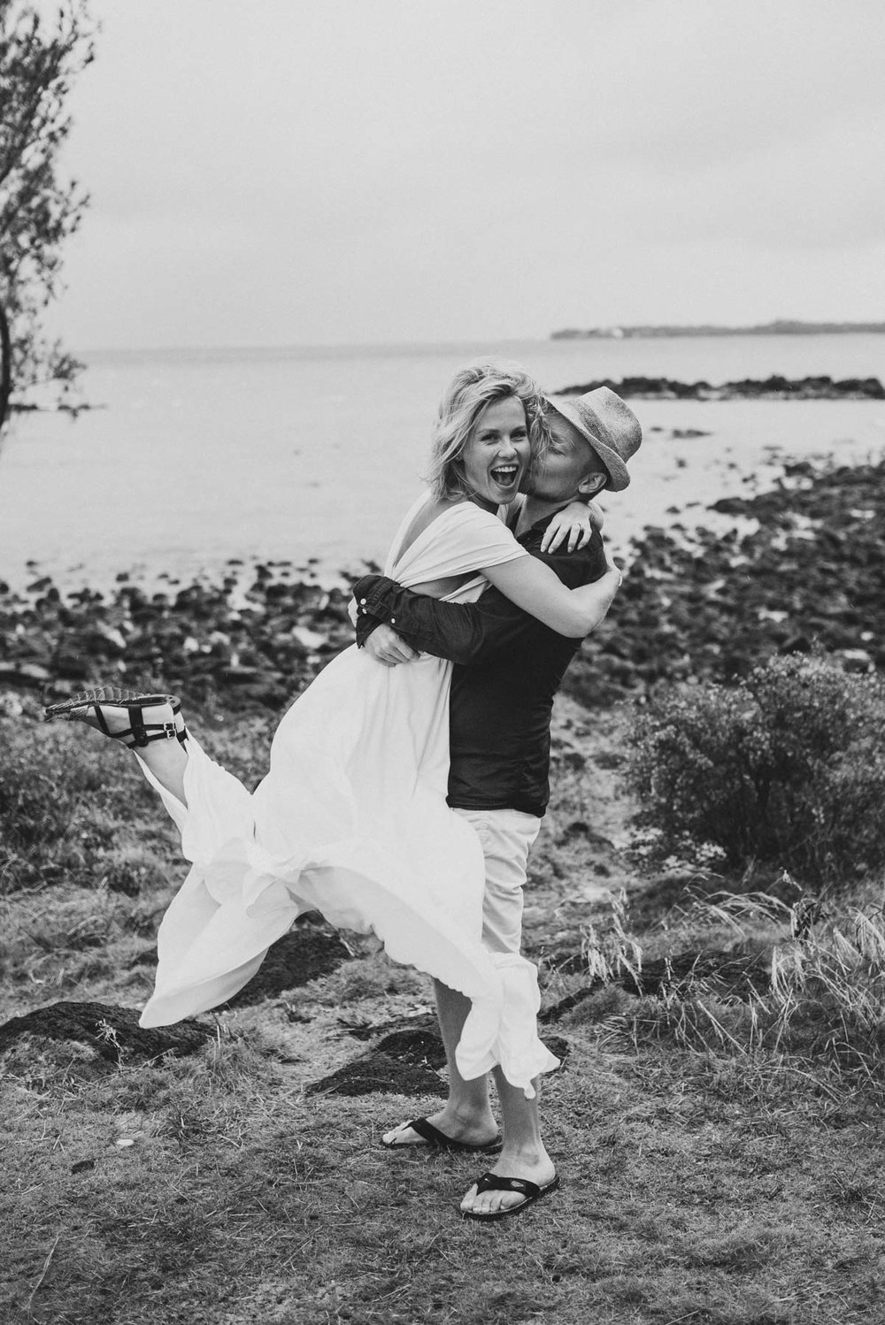 Copy of Sita Kelly | Mauritius Honeymoon Photographer | man lifting woman up, woman laughing