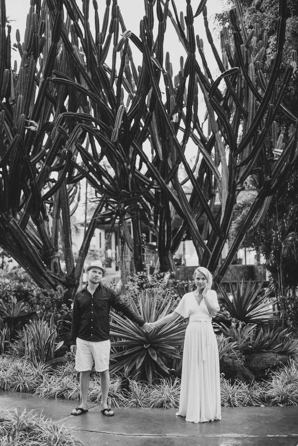 Copy of Sita Kelly | Mauritius Honeymoon Photographer | Coupleholding hands in front of a cactus