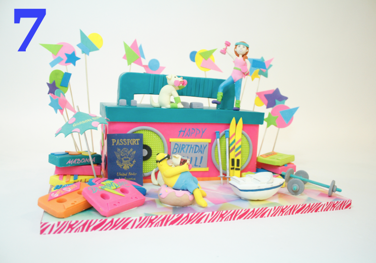 What a fun way to honor an 80's kid's birthday! We made this cake for a bday girl who grew up in and loved all things 80's. This design hits all the marks- bright neon colors, cassette tapes, aerobics, and awesome 80's sports gear. The actual cake is in the cassette player and each 80's item was sculpted with care out of gumpaste and fondant.