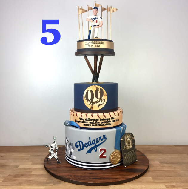 It was an honor to make a cake for the living legend that is Tommy Lasorda. The iconic coach got to see his beloved LA Dodgers go all the way to the world series this year! What we loved about this cake was all the easter eggs that were hidden in the design. Did you know Tommy Lasorda has a comet named after him? We got to learn a lot about the legendary coach and we included it all! His figure is modeled after his portrait in the Smithsonian and the story of how he met his wife is on there too. This cake was extra special since we made it watching the Dodgers make their way to the world series.