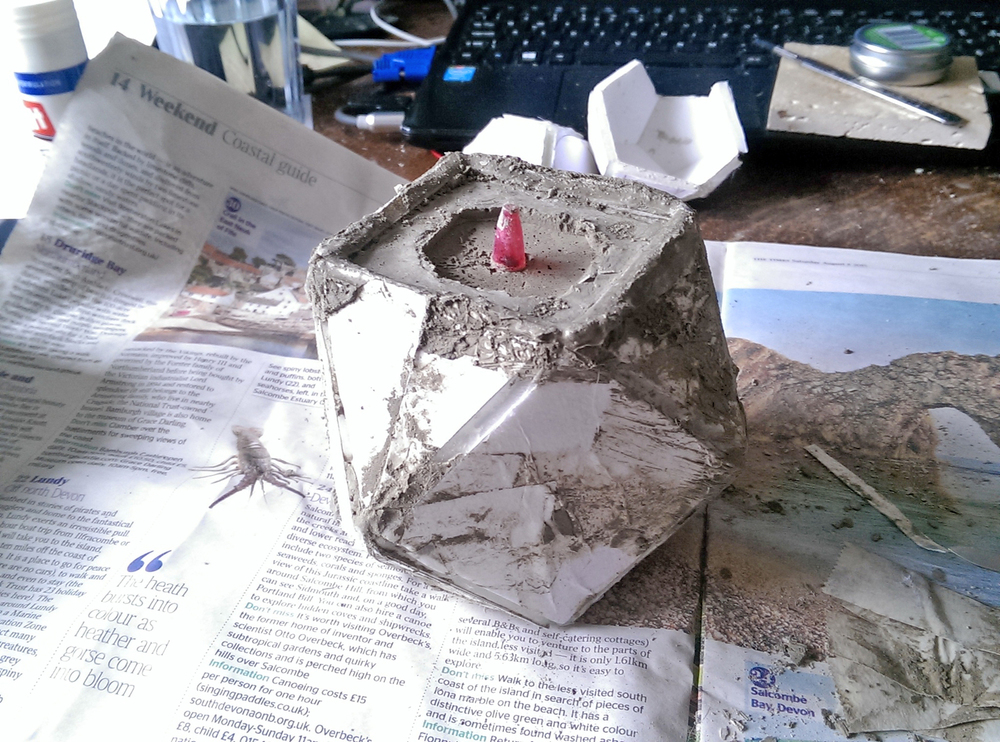 ⬆ - A drainage hole was created using a pen. This already had a draft and helped when removing the casting from the mould.