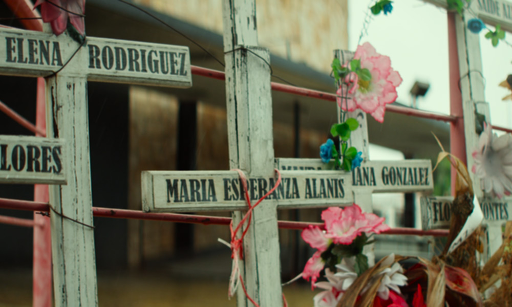 Crosses-and-flowers-on-railing.jpg
