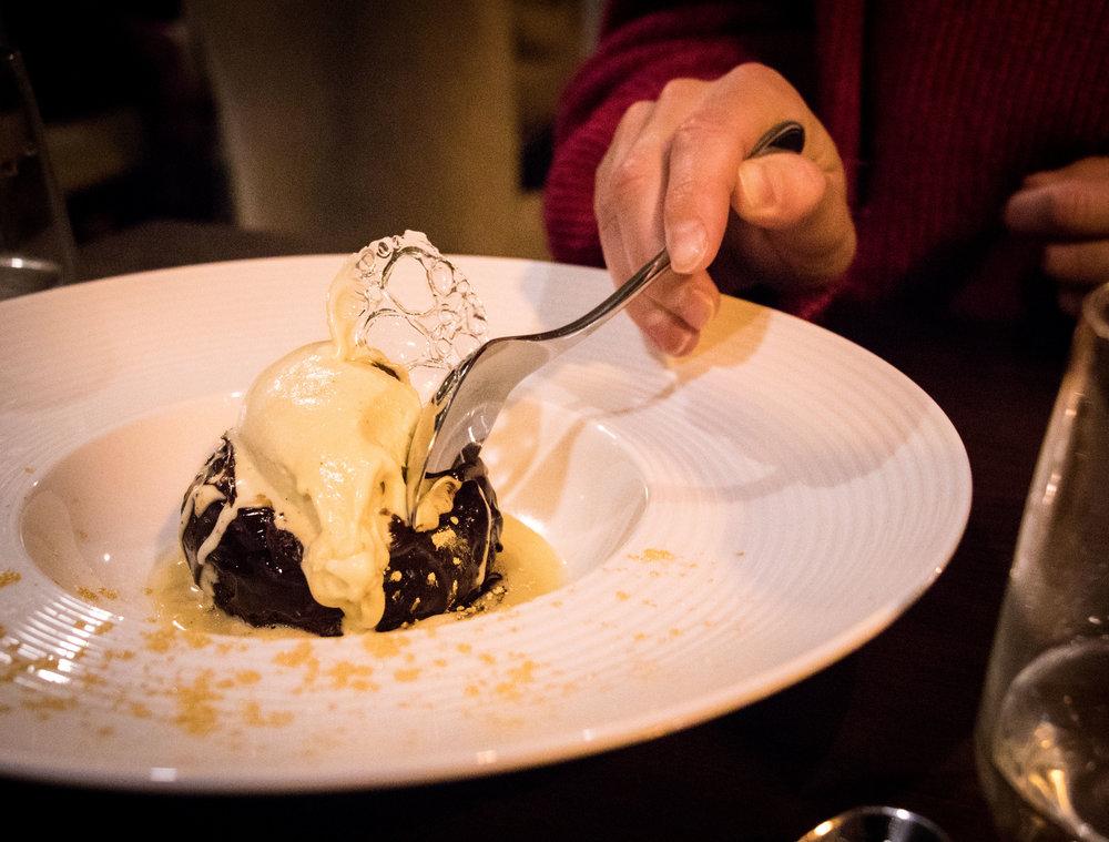 'Flourless chocolate cake with custard ice cream and warm white chocolate sauce' (£6)